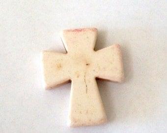 Medium Cream Colored Stone Cross