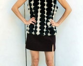 SALE - mod FAUX FUR 60s inspired black and ivory geometric patterned vest. winter. sexy.  Size small to medium.