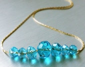 Carrie's Paris Sex and the City Crystal Necklace. Light Sapphire Blue and 18K gold