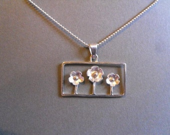 framed flowers, sterling silver pendant