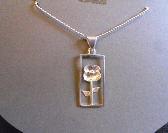 framed flower, sterling silver pendant
