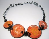 Stunning Orange/Yellow Spiral Necklace with Black Artistic Wire Neck Band Handmade from Polymer Clay