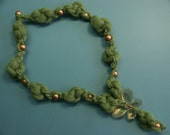 GREEN WOOL NECKLACE WITH A ORANGE BUTTERFLY PENDANT