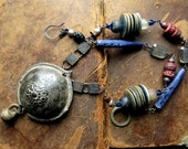 the fire sermon. archaic tribe necklace.