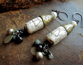 voice of the ancient bird. antique sacred tibetan shell earrings.