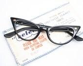 Reserved: cat eye glasses black  vintage cateye eyeglasses