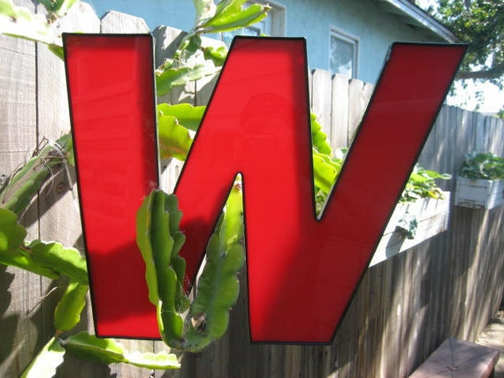 """Large Red & Black Reclaimed Translucent Plastic Advertising Sign Letter - Salvaged 14"""" x 18"""" Capital 'M' or 'W' in Slanted Italic Font"""