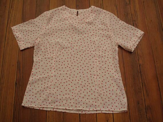 women's vintage pink polka dot blouse.