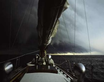 Classic Wooden Sailboat Approaching a Storm On Lake Erie
