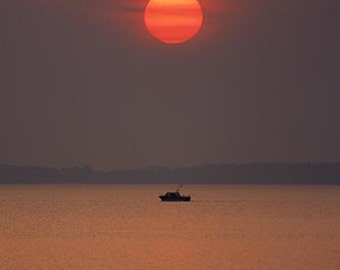 The Sun Rises On a Lone Boat Headed to the Fishing Grounds on Western Lake Erie