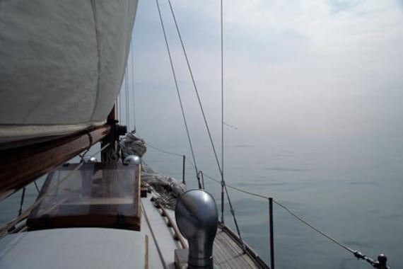 Classic Wooden Sailboat  Sailing in the Fog on Lake Erie