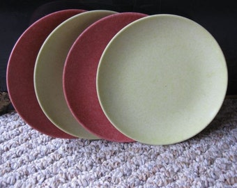 A Set of Four Peacock Maplex Dessert Plates in Raspberry and Lemon