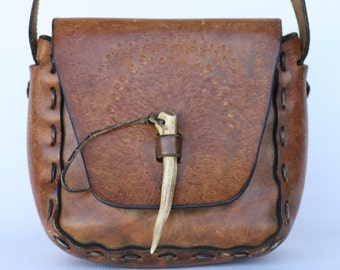 Nice Boho vintage hand made, hand tooled hippie leather shoulder bag, purse with an ivory pick...