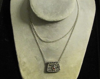 A sterling silver purse necklace