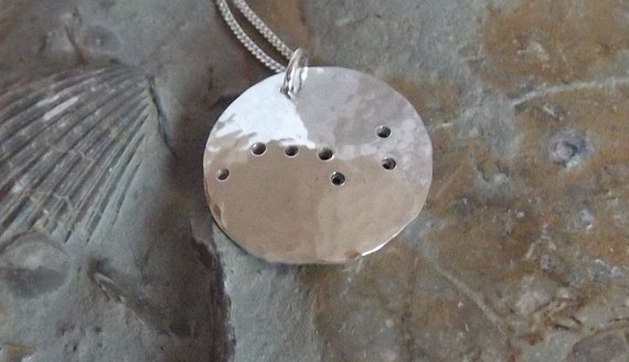 Big Dipper pendant: The constellation of the Plough on a domed sterling silver disc.