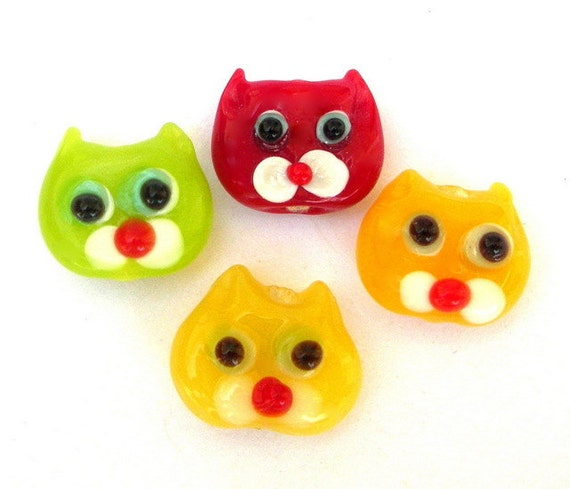 4 TINY cat face beads, lampwork glass, red, green and yellow