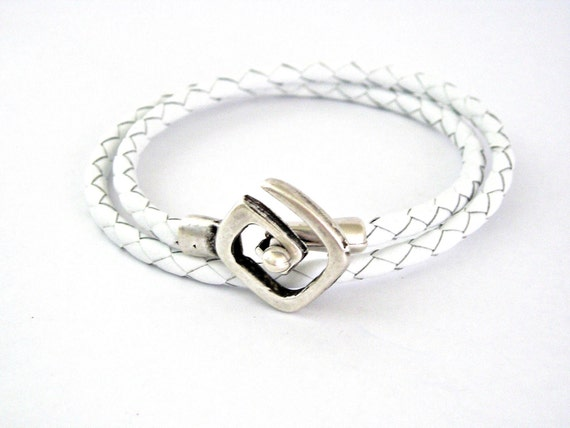 Double wrapped white braided leather bracelet with spiral toggle clasp