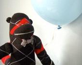 Sock Monkey - Black and Red Argyle
