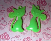 2 green cat pendents