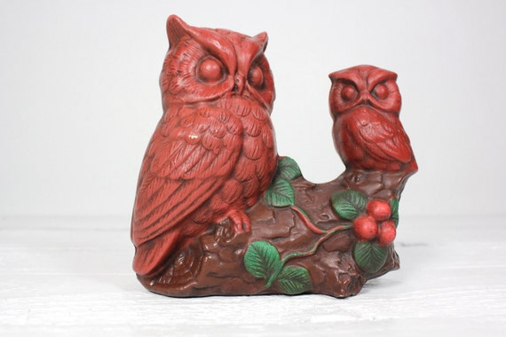 Two Deep Red Owls Perched on a Branch
