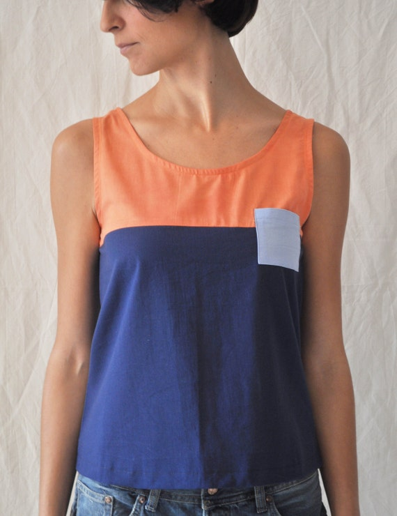 Navy tank top with orange block and blue pocket
