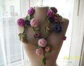 Ultra long green crochet lariat with lots of crochet rose flowers