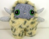 Lucas the horned plush monster grey and leopard print stuffed animal