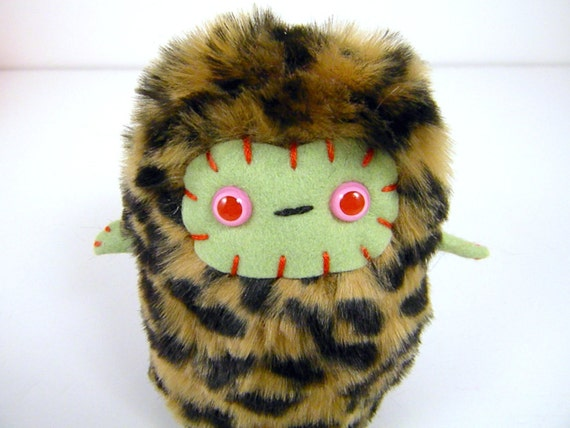 Berg the plush monster miniature leopard and green Little Uggle