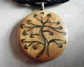 Tree of Life Symbol hand carved on a gold background. Pendant comes with a 3mm Leather Necklace