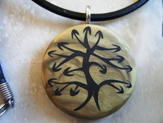 Tree of Life Symbol hand carved on a polymer clay antique gold color background. Pendant comes with a FREE Necklace