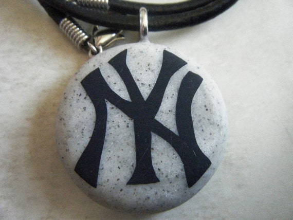 New York Yankees hand carved on a grey granite color background. Pendant comes with a FREE 3mm leather necklace
