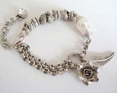 Pretty antique silver rose charm bracelet