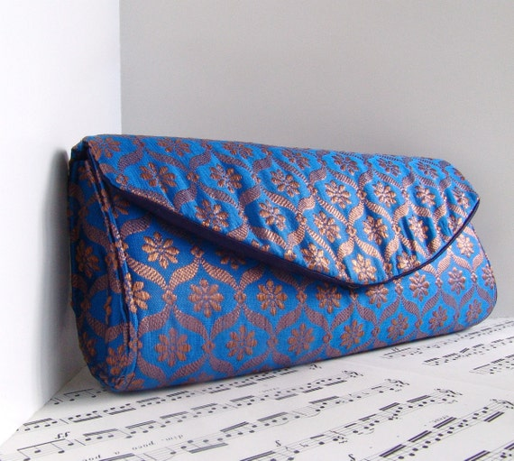 Christmas in July discount. Bright blue and gold silk brocade clutch purse