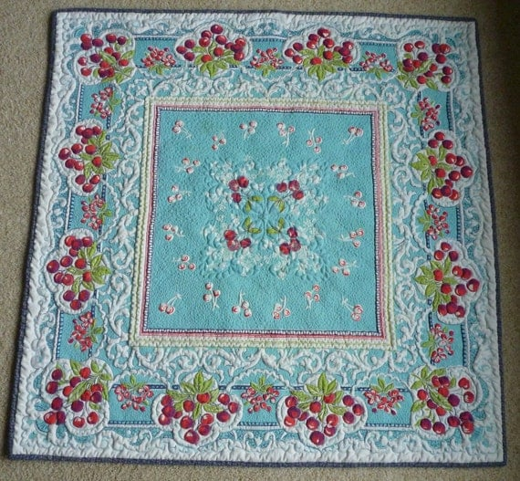 Aqua with red cherries quilted vintage tablecloth