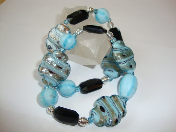 Carribean Waters Stretch Bracelet Duo in Aqua Blue and Black Lampwork beads with Silver Accents
