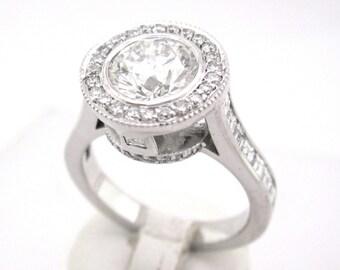Round cut diamond engagement ring bezel set 2.20ctw