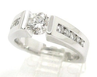 Round cut tension set diamond engagement ring 1.50ctw