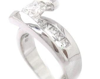 Round diamond engagement ring tension set 1.52ctw 18k