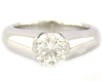 Round cut diamond engagement ring tension set 1.00ctw