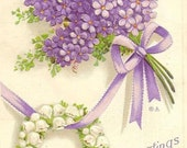 Purple Lilacs and Lily-of-the-Valley Horseshoe on vintage postcard 1912