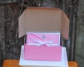 Pink Pastry Box filled with Hot Pink Birthday Cards topped with Glittered Chocolate Cake