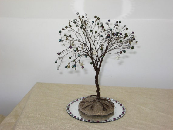 sculpture wire tree with silver stars on a mirror