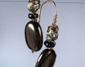Pyrite and Lapis Earrings Ovals Wire Wrapped with Lapis by dirtyrice on etsy