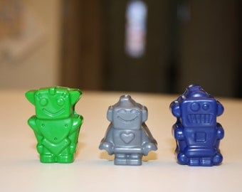 10 set of 3 robot crayons in cello bag tied with ribbon