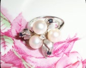 wonderfull and stunning art deco 14 kt white gold  ring with  3 pearls, diamond and 3 saphires.