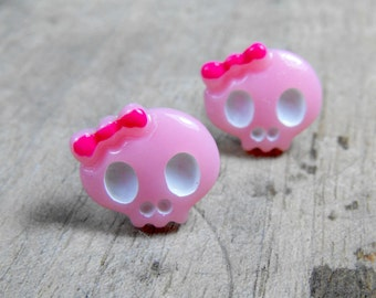 Tiny pink resin skull earrings with bow. Two pretty dead girls looking for a home. Super pink and super cute