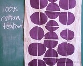 Tea towel screenprinted with Coins design in purple