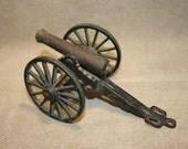 vintage cast metal toy cannon