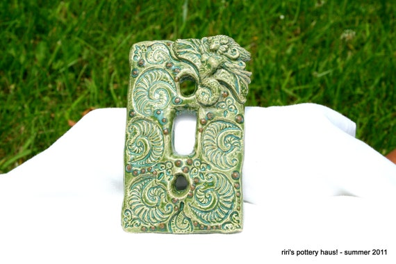 Mermaid and ammonite lightswitch plate in earth and sky
