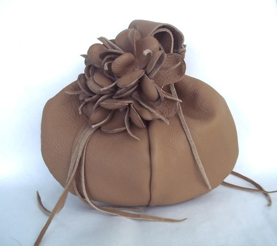 camel tan leather wristlet with  detachable flower